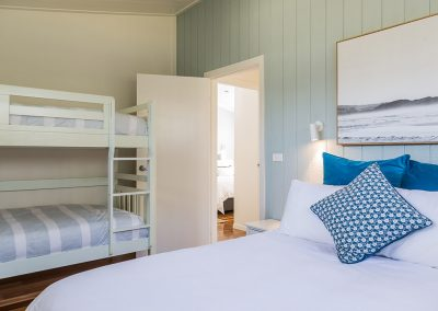 Surfside Cabin (sleeps 6) Queen Bedroom with bunks