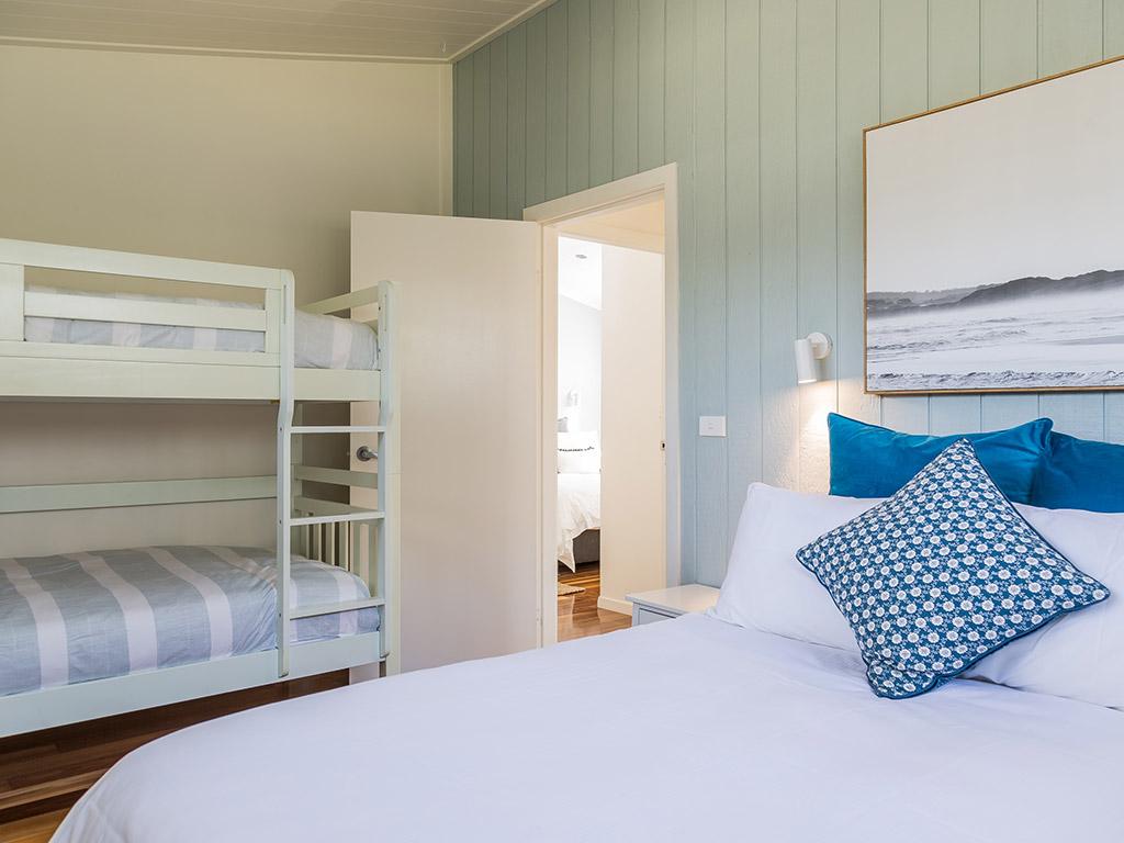 Surfside Cabin (sleeps 6) Queen Bedroom with bunks